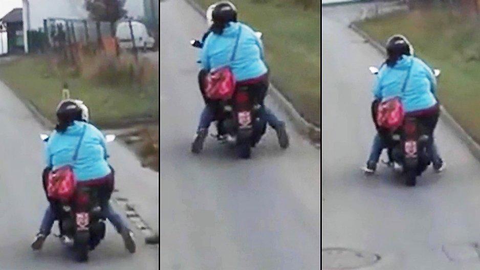 Une grosse sur un scooter
