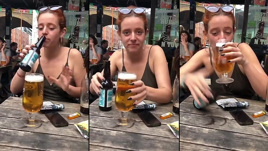 Une rouquine qui boit de la bière