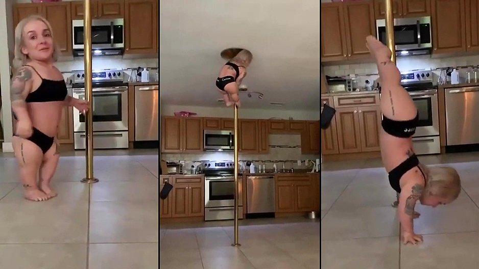 Une nana sur sa barre de pole dance